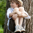 Stock Photo: Fair-haired boy in sneakers