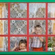 Стоковое фото: Two boys sit by the window