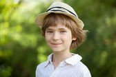 Smiling boy in the striped shirt — Stock Photo