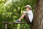 Boy sits on a bench — Stock Photo