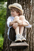 Fair-haired boy in sneakers — Stock Photo