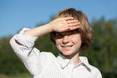 Little boy closes his hand from the sun — Stock Photo