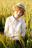 Boy wearing a hat stands — Stock Photo