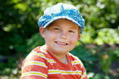 Cheerful boy in a cap — Stock Photo