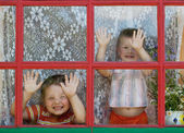 Two kids fool around and show the faces — Stock Photo