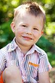 Merry disheveled boy — Stock Photo