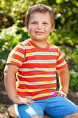 Confident boy in the striped shirt — Stock Photo