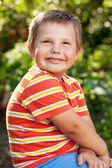 Gay boy in an orange shirt — Stock Photo