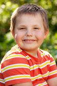 Merry brown-eyed boy — Stock Photo