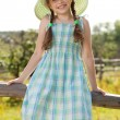Girl in a dress and hat — Stock Photo
