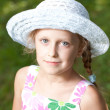 Charming blue-eyed girl in a hat — Stock Photo