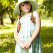 Girl in the hat and dress — Stockfoto