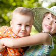Girl holds in her arms her brother — Stock Photo