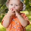 Charming babe eats delicious apple — Stock Photo