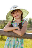 Dark-haired girl in a wicker hat — Stock Photo
