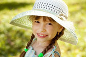 Girl in the hat and dress — Stock Photo