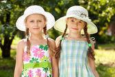 Two girlfriends in a wicker hats — Stock Photo