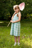 Funny, dark-haired girl with a butterfly net — Stock Photo