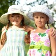 Two girlfriends in hats — Stock Photo