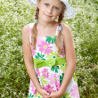 Girl with pigtails in the hat — Stock Photo