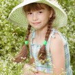 Pretty girl in a hat with braids — Stock Photo