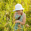 Little girl among the grass — Stock Photo