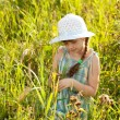 Stock Photo: Little girl among the grass