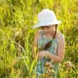 Little girl among the grass — Stock Photo