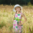 Beautiful little girl in a summer hat — Stock Photo