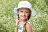 Charming blonde girl in a hat — Stock Photo