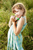 Dark-haired girl with pigtails — Stock Photo