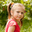Little girl in a red blouse — Stock Photo
