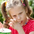 Foto Stock: Girl with appetite for eating ice cream