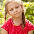 Sad little girl with pigtails — Stock Photo