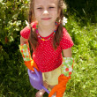 Little girl holding garden watering can — Stock Photo #12198530
