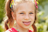 Little girl with pigtails — Stock Photo