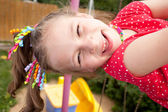 Frisky girl plays on the playground — Stock Photo