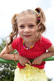 Smiling girl plays on the playground — Stock Photo