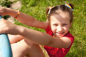 Funny little girl with pigtails — Stock Photo