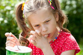 Girl with an appetite for eating ice cream — Stock Photo