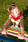 Girl with pigtails plays — Stock Photo
