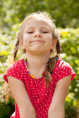 Portrait of a smiling little girl with braids — Stock Photo