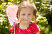 Smiling girl with a butterfly net — Stock Photo