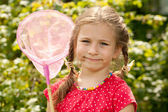 Little girl with a net — Stock Photo