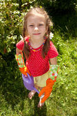 Little girl holding a garden watering can — Stock Photo