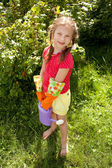 Little girl holding a watering can — Stock Photo