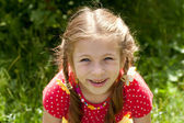 Portrait of laughing girl with pigtails — Stock Photo