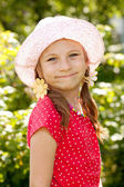 Smiling girl with pigtails — Stock Photo