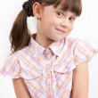 Little funny girl on light background — Stock Photo