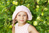 Funny girl next to the apple tree — Stock Photo